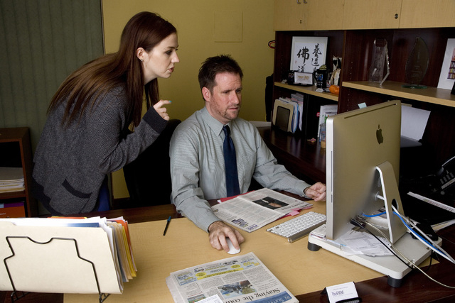 Jasen Woehrle, senior vice president of The Firm Public Relations and Annie Waggoner, public relations coordinator are seen editing ad content in his office located at 6157 S. Rainbow Blvd., in La ...