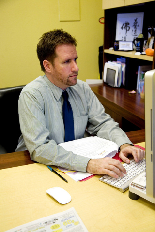 Jasen Woehrle, senior vice president of The Firm Public Relations, edits ad content in his office located at 6157 S. Rainbow Blvd., in Las Vegas on Friday, August 15, 2014. (Jeferson Applegate/Las ...