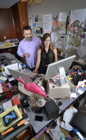 Alex Raffi, senior partner and creative director at iMAGiNE Communications, left, works on a website with art director Cynthia Carbajal at the firm's offices at 11500 S. Eastern Ave. in Henderson  ...