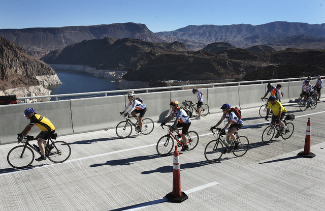Cyclists cross the yet to be opened U.S. Highway 93 Hoover Dam bypass bridge during the Regional Transportation Commission Viva Bike Vegas 2010 bicycle race on Saturday morning, Oct. 9, 2010. (Jas ...