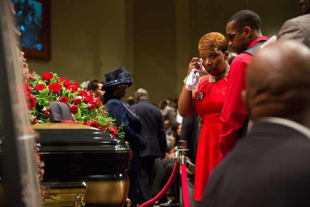 Lesley McSpadden stands at the casket the of her son Michael Brown during his funeral at Friendly Temple Missionary Baptist Church in St. Louis, Monday, Aug. 25, 2014. Hundreds of people gathered  ...