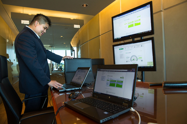 Jason Chan, market development manager for CenturyLink, demonstrates an Internet speed test for customers at the company's Las Vegas office, located at 6700 Via Austi Parkway, Friday, Aug. 1, 2014 ...