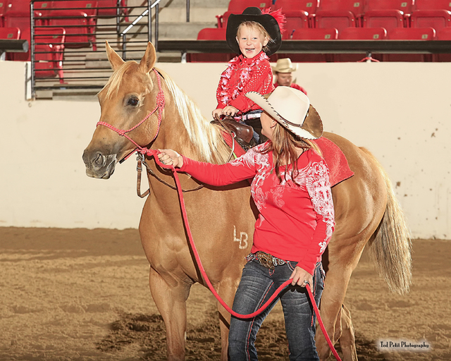 Marla Stevens walks a horse with her daughter Bailey at the third annual Buckles and Barrels for Bailey charity event in 2013 at the South Point, 9777 Las Vegas Blvd. South. The event benefits the ...