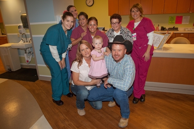 Marla Stevens, front left, and her husband Patrick, front right, pose with their daughter Bailey, front center, and nurses at Spring Valley Hospital, 5300 S. Rainbow Blvd. The hospital's neonatal  ...