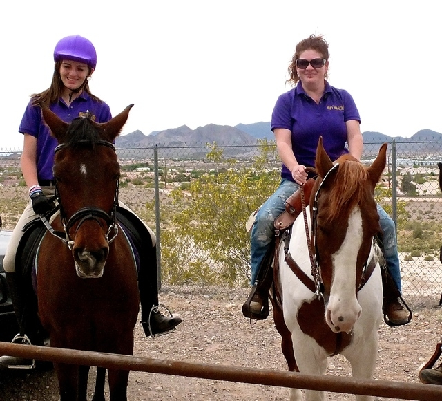Lauren Sokolowski, left, and Amy Meyer ride horses while participating in a White Horse Youth Ranch program. (Special to View)