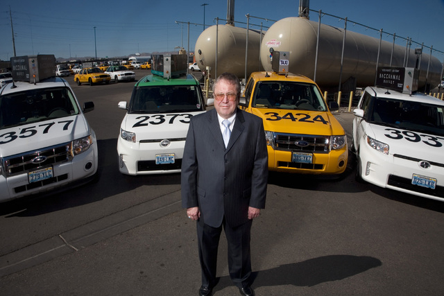 Jeferson Applegate/Las Vegas Business Press Gene Auffert, CEO of Yellow Checker Star Corporation,  stands before a fleet of his cabs that run on propane fuel at the Yellow Checker Star Corp. offic ...