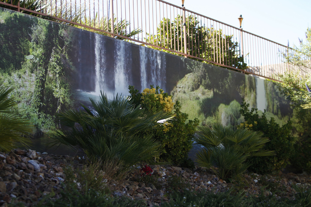 Erik Verduzco/Las Vegas Review-Journal A waterfall scene print created by Wall Sensations decorates a backyard wall at the Summerlin home of Roger Weaver.