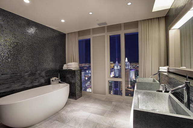 Courtesy photo  The Mandarin Oriental penthouse's master bath features windows with electronic shades.
