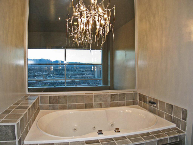 Courtesy photo  The master bath in the Newport penthouse features a chandelier.