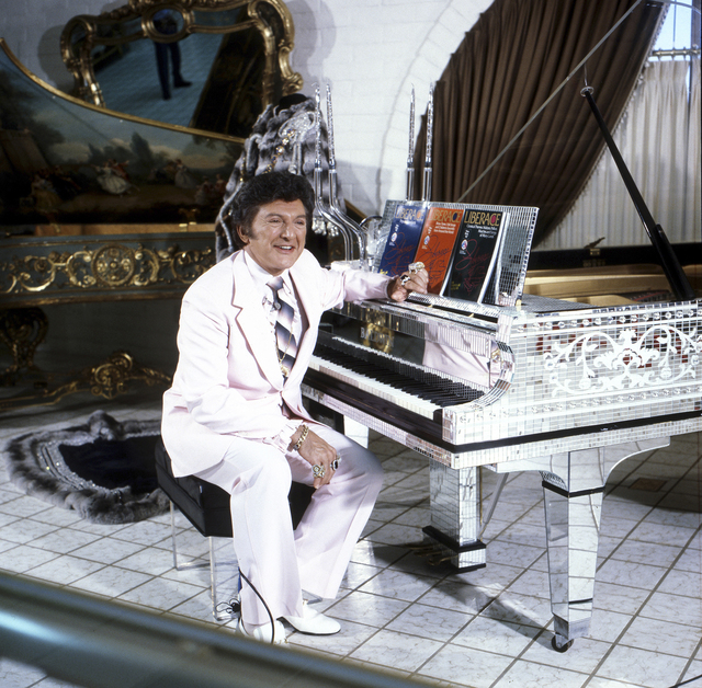 Photo courtesy Las Vegas News Bureau  Liberace poses at a piano in his namesake museum at when it opened at 1775 E. Tropicana Ave. in 1979.