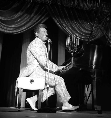 Photo courtesy Las Vegas News Bureau  Liberace plays the piano at the opening at the Sahara Hotel June 21 1966.