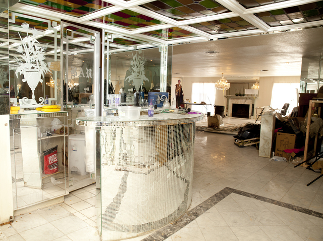 Tonya Harvey/Real Estate Millions A bar decked out to look like a disco ball is a reminder of the mansion's previous owner.