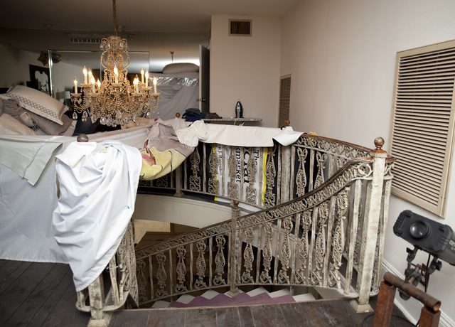 Tonya Harvey/Real Estate Millions The French staircase leads to the second floor of the mansion where there is yet another elaborate chandelier.