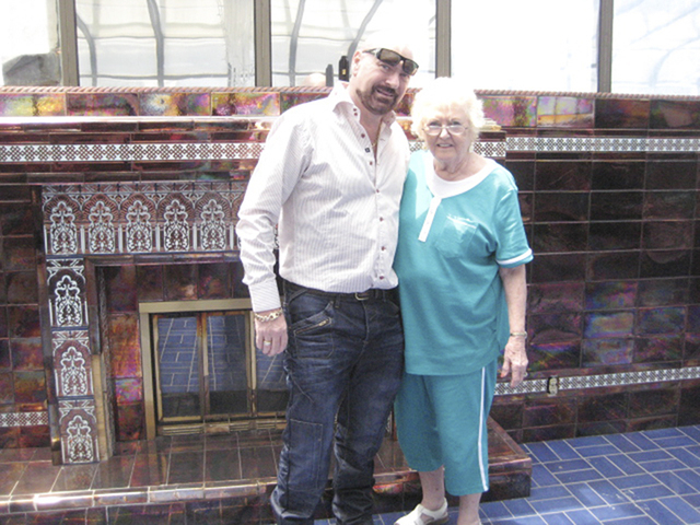 """Courtesy Martyn James Ravenhill The mansion's new owner Martyn James Ravenhill poses with Nedra Rodheim, a former Liberace Museum staffer, in front of the fireplace in the second-fllor """"Moroccan ..."""