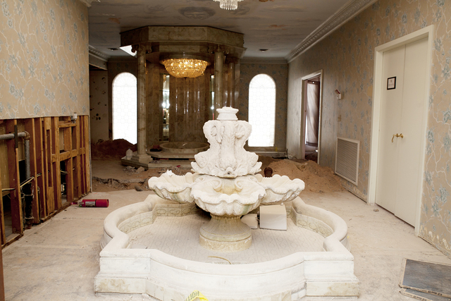 Tonya Harvey/Real Estate Millions A large fountain is on the first floor of the mansion.