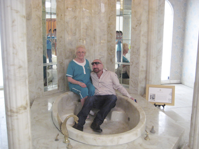 Courtesy Martyn James Ravenhill The mansion's new owner Martyn James Ravenhill poses with Nedra Rodheim, a former Liberace Museum staffer in the master bath. Liberace was photographed in the bath  ...