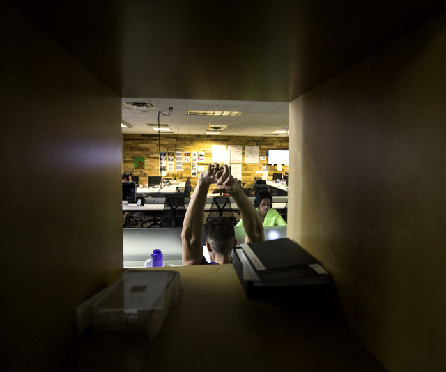 Ryan Cormier, founder and president of Forward Digital stretches while working at  Work In Progress,  317 S. 6th Street, on Wednesday, Aug. 20, 2014.  The  co-working center provides services and  ...