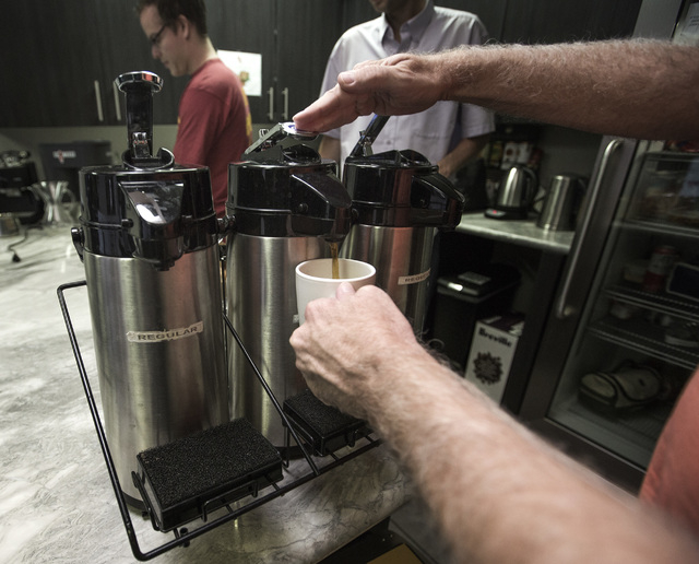 A group gathers for morning coffee at  Work In Progress,  317 S. 6th Street, on Wednesday, Aug. 20, 2014. Local startups meet on Wednesday's for coffee and donuts. The  co-working center provides  ...