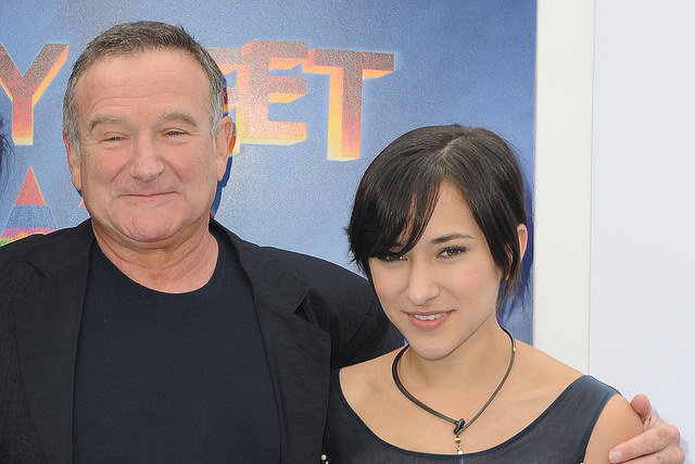 """This Nov. 13, 2011 file photo shows actor Robin Williams, left, and his daughter, Zelda at the premiere of  """"Happy Feet Two"""" in Los Angeles. Williams, whose free-form comedy and adept impressions  ..."""