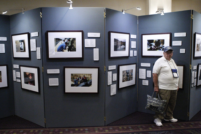 "Daniel Flynn, U.S. Army Vietnam War veteran, stands in front of the ""Always Lost: A Meditation on War"" exhibit during the National Disabled American Veterans and Auxiliary Convention at  ..."