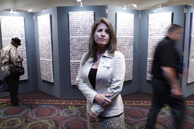 "Amy Roby, projector manager of the ""Always Lost: A Meditation on War"" exhibit, poses for a portrait in front of the exhibit during the National Disabled American Veterans and Auxiliary C ..."