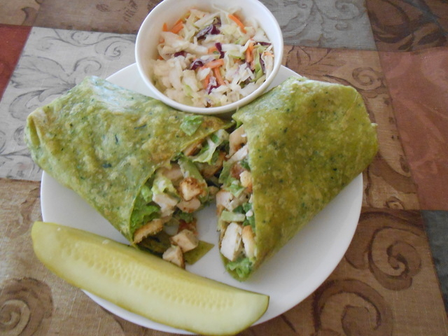 A chicken Caesar wrap on a spinach tortilla is shown at Distill, 4830 W. Pyle Ave. (Jan Hogan/View)