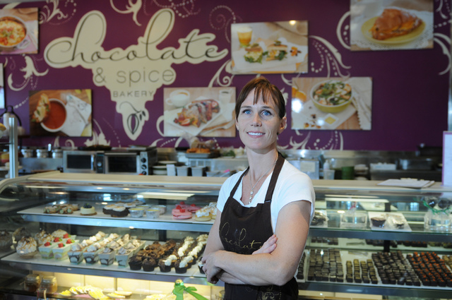 Megan Romano, owner of Chocolate & Spice Bakery, 7293 W. Sahara Ave., stands in front of her shop's display case, Aug. 8. She said she first gained culinary expertise helping out in her mother's ...