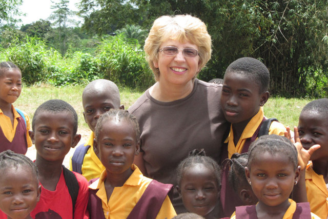 This Oct. 7, 2013, photo provided by Jeremy Writebol show his mother, Nancy Writebol, with children in Liberia. Writebol is one of two Americans working for a missionary group in Liberia who have  ...