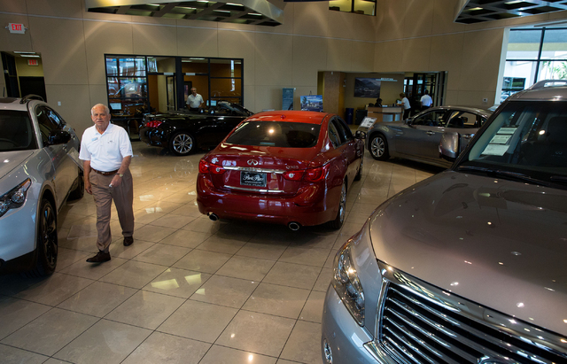 Ralph Planzo (cq) walks through the Park Place Infiniti showroom, located at 5605 W. Sahara Ave., Wednesday, Aug. 13, 2014. The dealership is adding a 20,000-square-foot building and renovating it ...