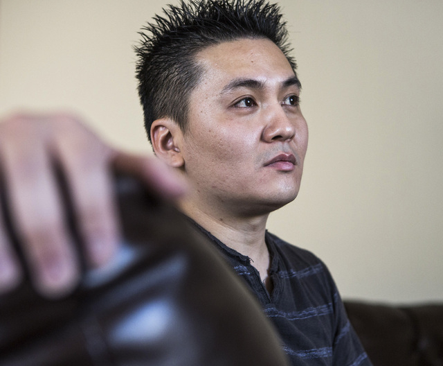 Bobby Tran  at his home in Las Vegas  on Monday, Aug. 25, 2014. Tran and his wife Ha Le lost their Health Plan of Nevada coverage because the exchange is telling the insurer the young couple have  ...