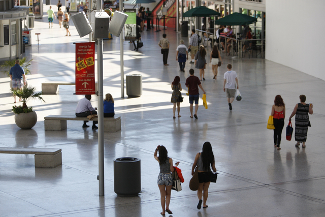 People walk along Fashion Show mall near their Strip entrance where an expansion and redevelopment is planned to accommodate more restaurants and retail stores in Las Vegas Tuesday, Aug. 26, 2014. ...