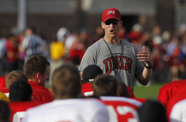Head coach Bobby Hauck talks to his players during UNLV's annual spring football game at Peter Johann Memorial Field in Las Vegas in April. (Jason Bean/Las Vegas Review-Journal File)