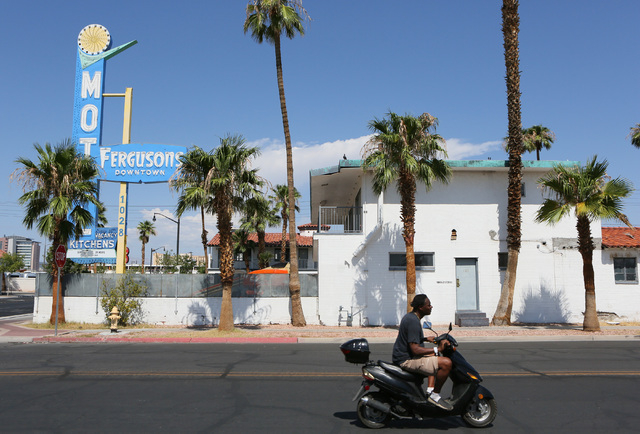 A man rides past Fergusons Motel, located at 1028 East Fremont St. Friday, Aug. 1, 2014, in Las Vegas. Downtown Project plans to transform the closed hotel into a retail center. (Ronda Churchill/L ...