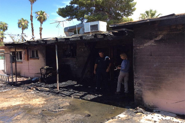 """Teen tried taking pan on fire to back patio, but dropped it, house fire. Teen/dog escaped. 2nd cooking fire today,"" Las Vegas FireRescue tweeted. (courtesy Tim Szymanski, Las Vegas Fire Department)"