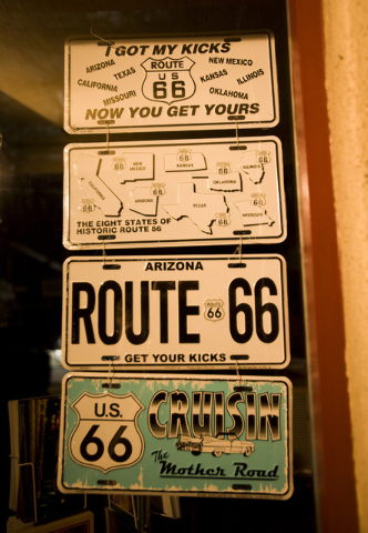 A Route 66 license plate in the window at the Peace Surplus   in downtown Flagstaff, Arizona, on July 11, 2009. The famous highway went through Flagstaff. (JEFF SCHEID/LAS VEGAS REVIEW-JOURNAL)