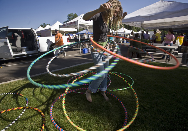 A hula hoop performer works for tips at the Flagstaff Community Market  in Flagstaff, Arizona, on Sunday, July 12, 2009. (JEFF SCHEID/LAS VEGAS REVIEW-JOURNAL)