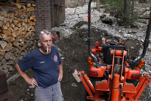 Duffy Grismanauskas is interviewed about the damage to his home after a flood outside of his home at the Rainbow Canyon subdivision at Mount Charleston Wednesday, July 30, 2014. (Erik Verduzco/Las ...