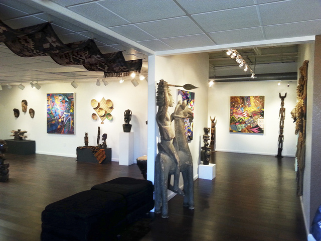 Art pieces are seen on display at the Rhythms of Africa exhibition at the Left of Center Art Gallery, 2207 W. Gowan Road, July 2014. An official ribbon cutting is set at 5 p.m. Aug. 29 and an open ...