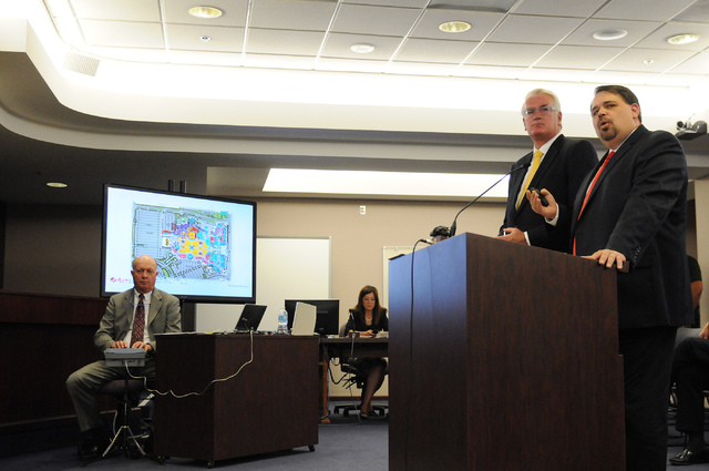 Christian Goode, CFO/Sr. VP Development Genting Americas, right, and his attorney Mark Clayton present their project for a new casino and hotel during a hearing at the Nevada Gaming Commission at  ...