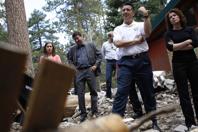 Gov. Brian Sandoval, center, inspects the flood damage at the Rainbow Canyon subdivision at Mount Charleston during a tour Friday, Aug. 1, 2014. (Erik Verduzco/Las Vegas Review-Journal)
