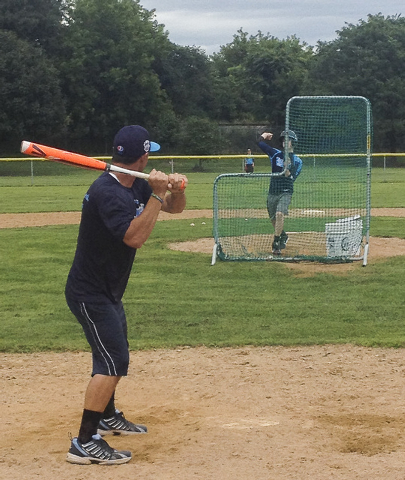 Mountain Ridge Little League manager Ashton Cave, left, turns the tables on a few of his players and takes batting practice from Austin Kryszczuk on Friday, Aug. 15, 2014 at the Little League Worl ...