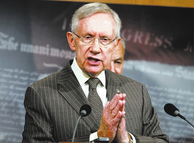 Senate Majority Leader Harry Reid of Nev. speaks during a news conference on Capitol Hill in Washington, Wednesday, June 11, 2014, where he talked about student loan legislation and the defeat of  ...