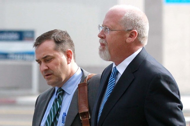 Harvey Whittemore, right, and his attorney John Arrascada walk from the federal courthouse in Reno, Nev., on Thursday, June 7, 2012. Whittemore pleaded not guilty to charges of violating federal c ...