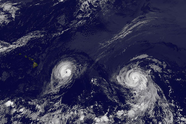 This image provided by NOAA taken Thursday, Aug. 7, 2014, at 2 a.m. EDT shows Hurricane Iselle, left and Hurricane Julio. The center of Iselle is expected to pass very near or over the Big Island  ...