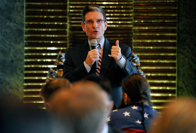 U.S. Rep. Joe Heck, R-Nev., speaks during the Nevada Republican Men's Club luncheon at the Bali Hai Golf Course Clubhouse on Monday, Aug. 4, 2014. (David Becker/Las Vegas Review-Journal)