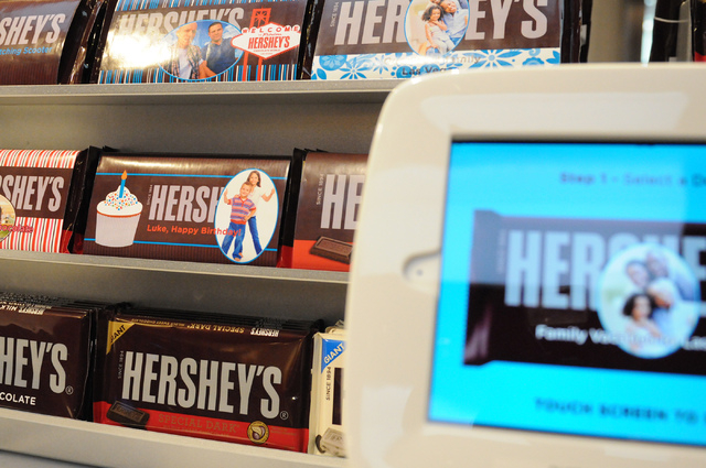 A computer allows costumers to customize their Hershey's chocolate wrappers during the grand opening ceremony of Hershey's Chocolate World at New York-New York casino-hotel in Las Vegas Tuesday, J ...