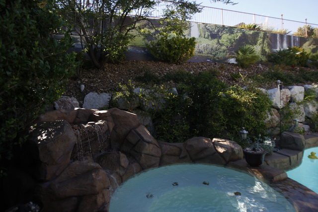 A waterfall scene print created by Wall Sensations decorates a backyard wall at the home of Roger Weaver in Las Vegas Friday, Aug. 15, 2014. (Erik Verduzco/Las Vegas Review-Journal)