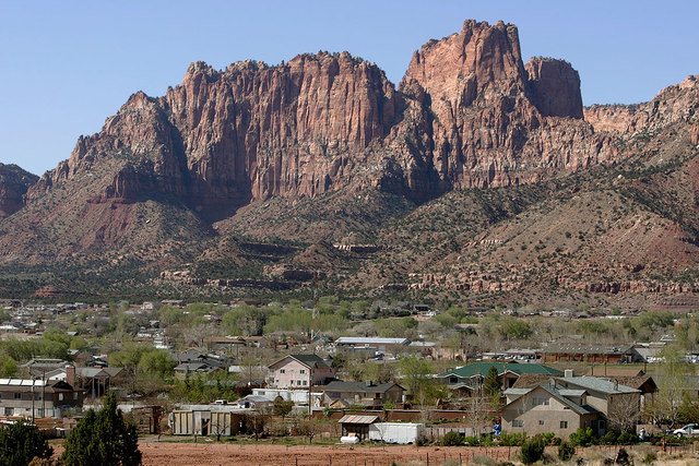 Hildale, Utah, sits at the base of Red Rock Cliff mountains with its sister city, Colorado City, Arizona, in the foreground. Utah's liquor commission has approved a winemaking license for a new wi ...