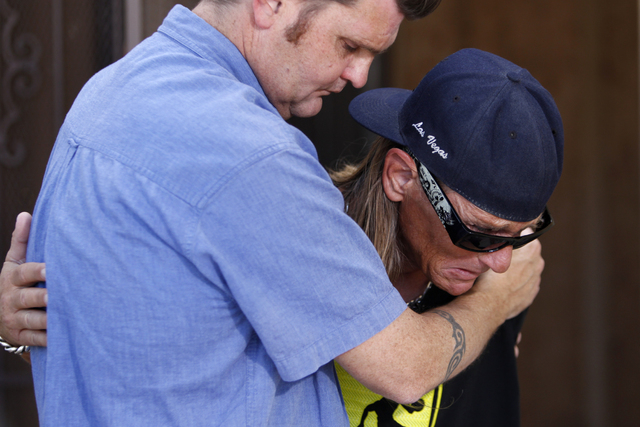 News producer Kean Bauman, left, comforts John Hastrich as he becomes emotional during an interview on the death of his girlfriend Terri Ham outside of his home, 3899 Almondwood Drive in Las Vegas ...