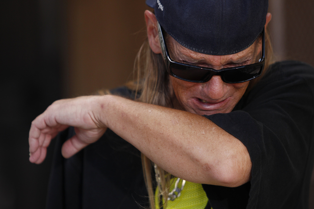 John Hastrich becomes emotional during an interview on the death of his girlfriend Terri Ham outside of his home, 3899 Almondwood Drive in Las Vegas Friday, Aug. 22, 2014. Ham died at the hospital ...